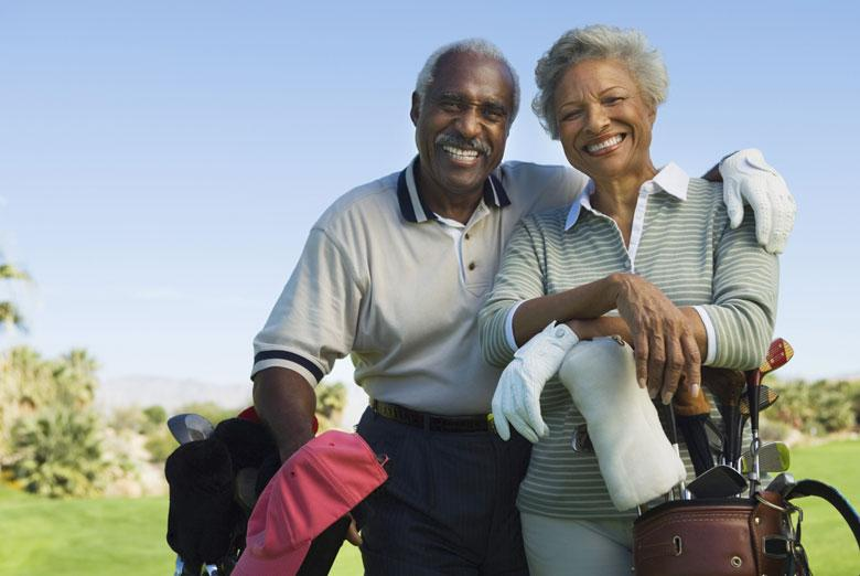 Older Couple Playing Golf